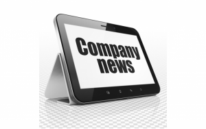 A tablet with a title on screen: Company News